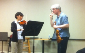 BSO Concertmaster Jonathan Carney coaches a BSO Academy player.